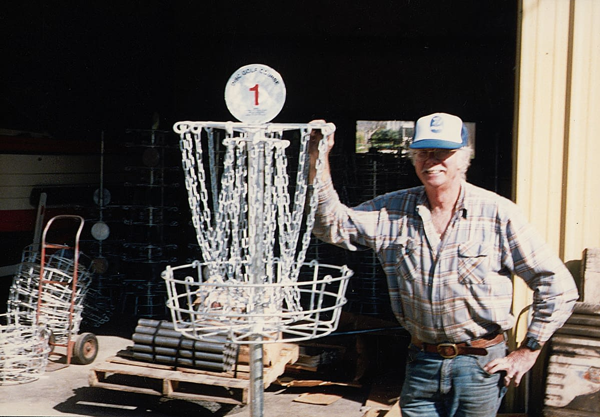 Ed Headrick working on a basket prototype design he would later patent and release as the Mach III.